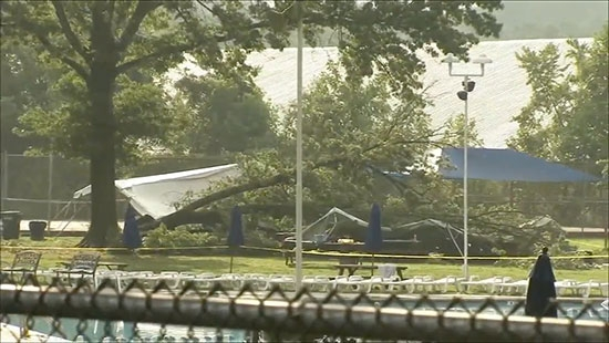 Tree Falls on Tent, 9 Injured; Plane Crash in Delaware, 2 Dead; Heat Wave Continues